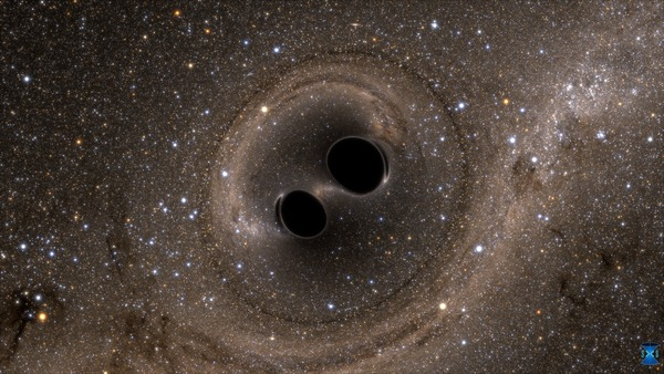 Computer simulation image showing the merger of two black holes.